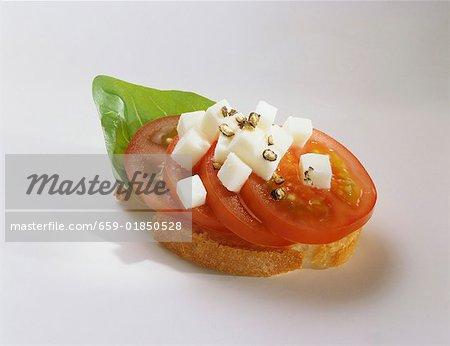 Canapé: tomato, mozzarella and basil on slice of baguette