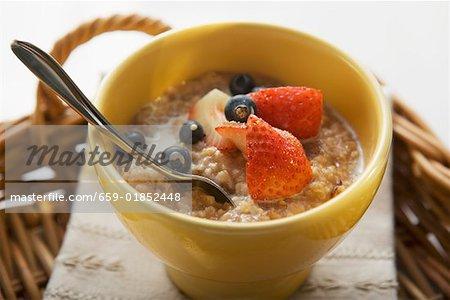 Porridge with milk and berries on tray