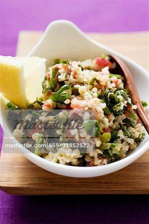 Pearl barley and parsley salad in a bowl