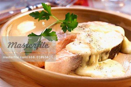 Salmon steak with cheese sauce