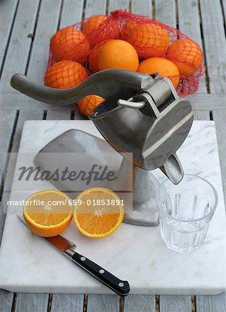 Juice press for making freshly pressed orange juice