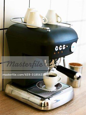 A cup of espresso on espresso machine