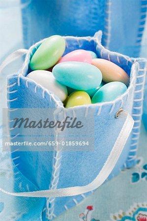 Sugared almonds in blue felt bag