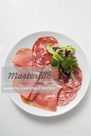 Sausage platter with raw ham and salami