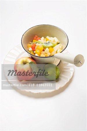 Fruit salad, apple and lime on plate