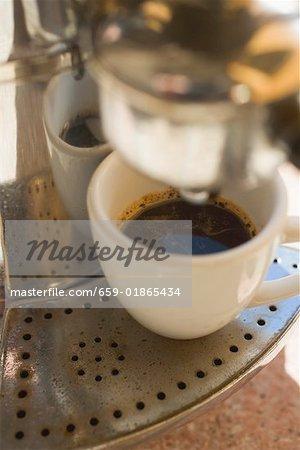 Espresso cup on espresso machine