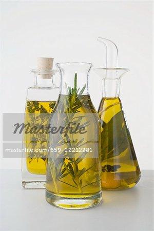 Three different herb oils in bottles