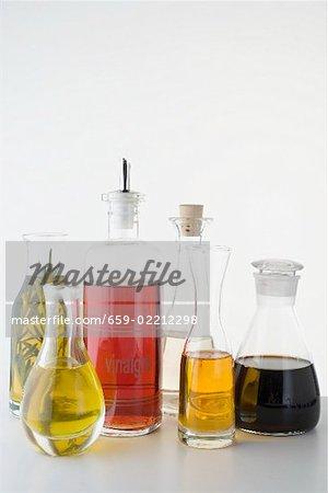 Various types of oil and vinegar in bottles