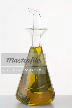 Herb oil with lemon peel in a bottle