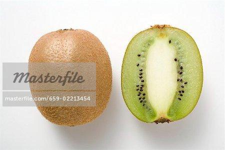 Whole kiwi fruit & half a kiwi fruit (longitudinal section)