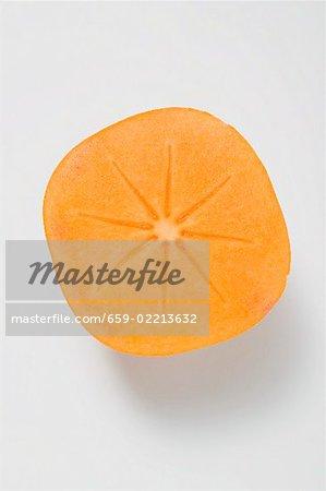 Half a persimmon (overhead view)