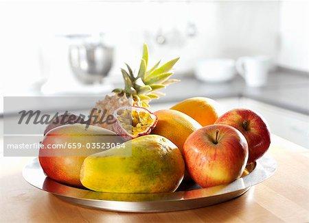Dish of fruit (apple, pineapple, papaya, mango, passion fruit)