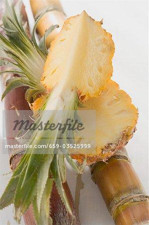 Pineapple quarter on half a pineapple