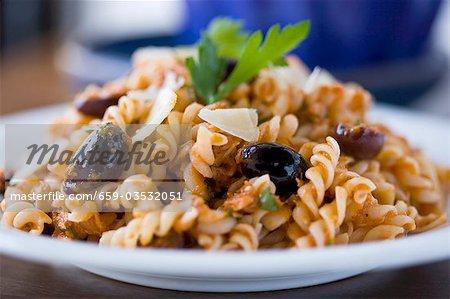 Fusilli Pasta with Tomato Kalamata Olive Sauce; Parsley Garnish