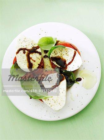 Tomatoes with mozzarella, basil and balsamic vinegar