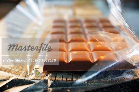 Nut milk chocolate in plastic wrapper
