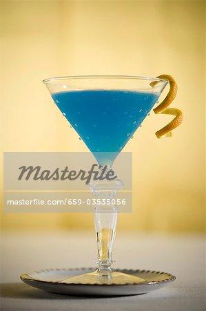 Blue Cocktail with Citrus Garnish