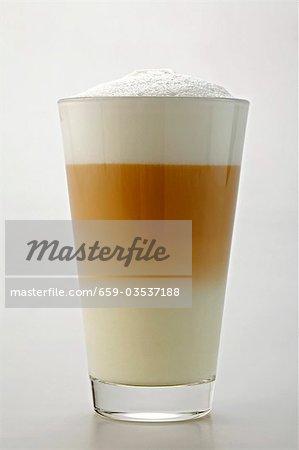 A glass of caffË latte