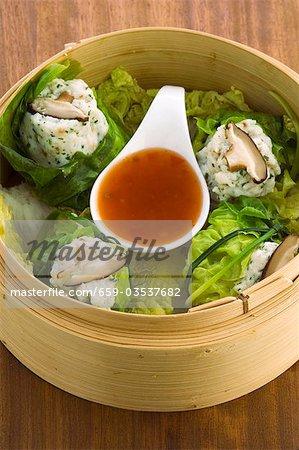 Steamed fish dumplings in bamboo basket (Asia)