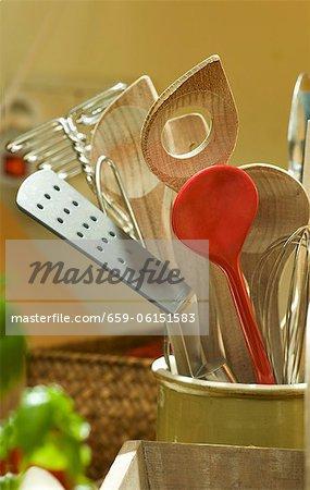 A pot of various kitchen utensils