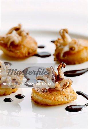 Fried scallops with calamari and balsamic vinegar