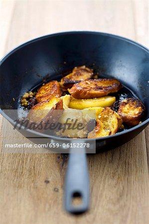 Shredded apple pancakes with raisins in a pan (Austrian dessert)