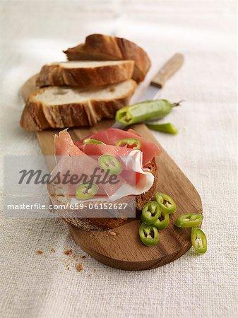 Open sandwich with serrano ham and chilli rings