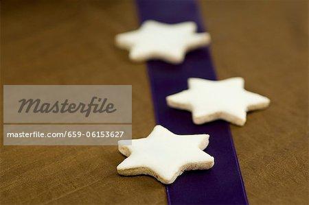 Three cinnamon stars on a purple stripe