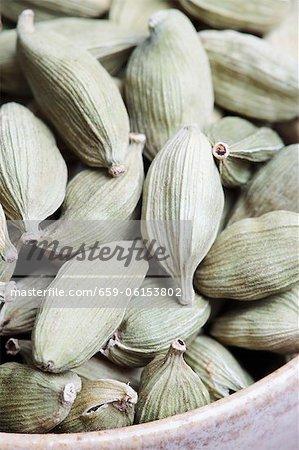Many dried cardamom pods