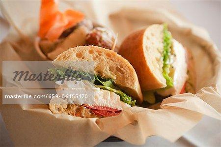 Mozzarella, Tomato and Romaine Sandwiches on Ciabatta; In Paper Lined Basket