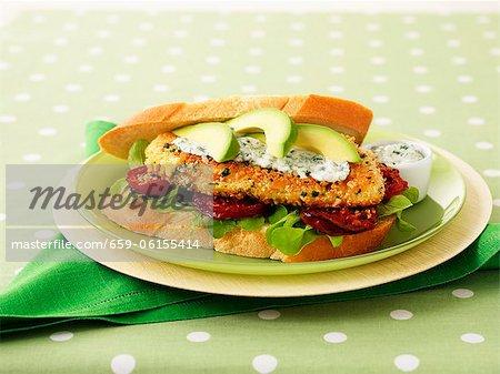 Peanut chicken, tomato and avocado sandwich