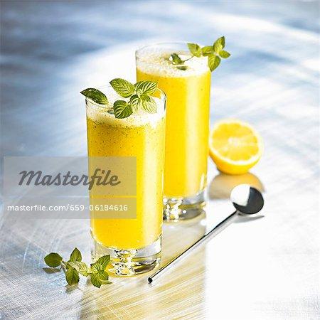 Orange drinks with honey, soda and mint