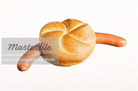 Bockwurst (German sausage) in bread roll