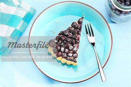 A slice of blueberry tart
