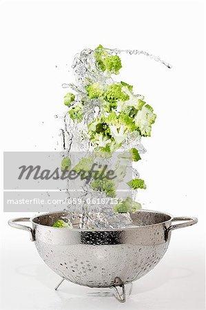Romanesco broccoli with a water splash in a colander