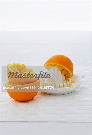 Squeezed oranges and citrus squeezer