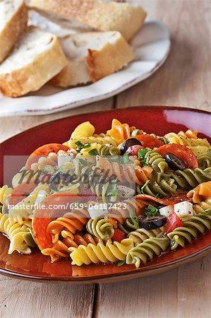 Tri-Colored Rotini Pasta Salad with Pepperoni, Mozzarella Cheese, Tomatoes and Black Olives