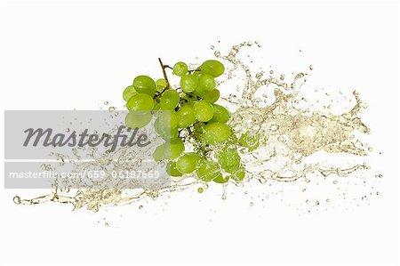 Green grapes with white wine splash