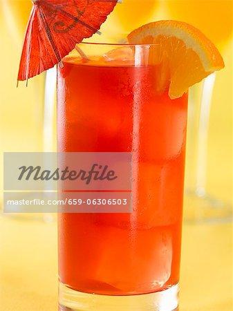 Singapore Sling Cocktail with Orange Wedge Garnish and Cocktail Umbrella