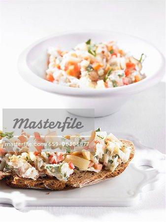 Crispy bread topped with sauerkraut and yogurt spread