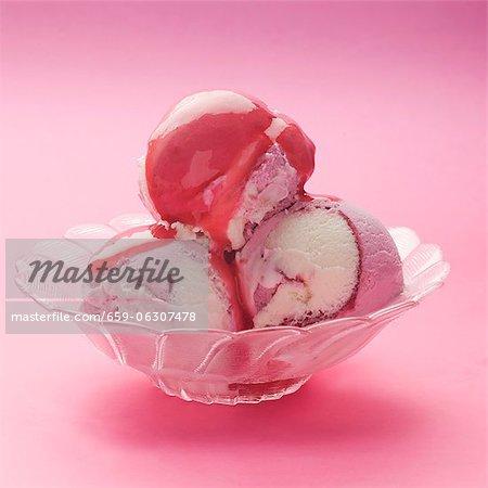 Raspberry and vanilla ice cream with raspberry sauce