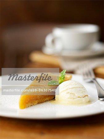 A piece of treacle tart with vanilla ice cream (UK)