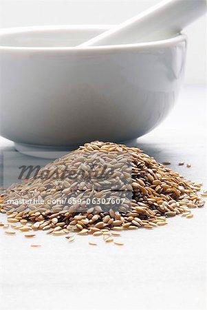 Organic Golden Flax Seeds; Mortar and Pestle