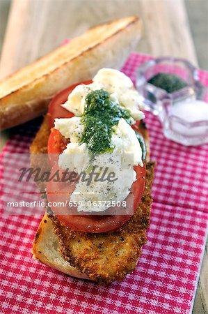 Breaded escallop, fresh tomato, mozzarella and pesto ciabatta sandwich
