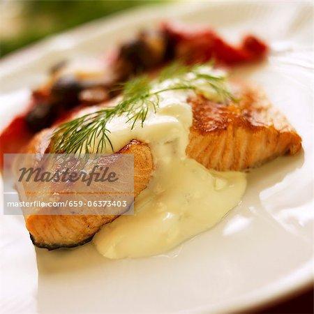 Salmon with Cucumber Cream Sauce and Dill Garnish