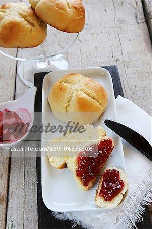 Homemade quark rolls with raspberry jam