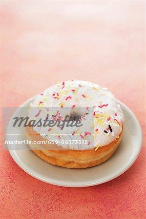 An iced doughnut with sugar sprinkles