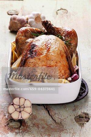 Roast chicken with lemons, garlic and rosemary