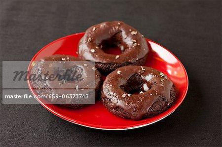 Three Gluten Free Vegan Chocolate Chili Doughnuts with Vanilla Infused Sea Salt; On a Red Plate