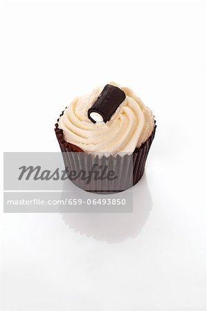 A cupcake decorated with a liquorice bonbon